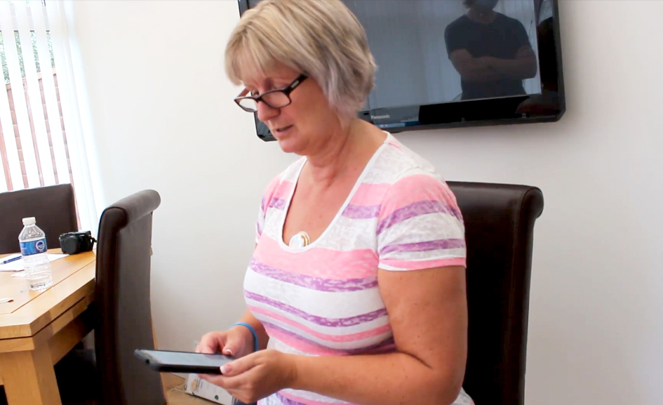 Woman looks at app on phone